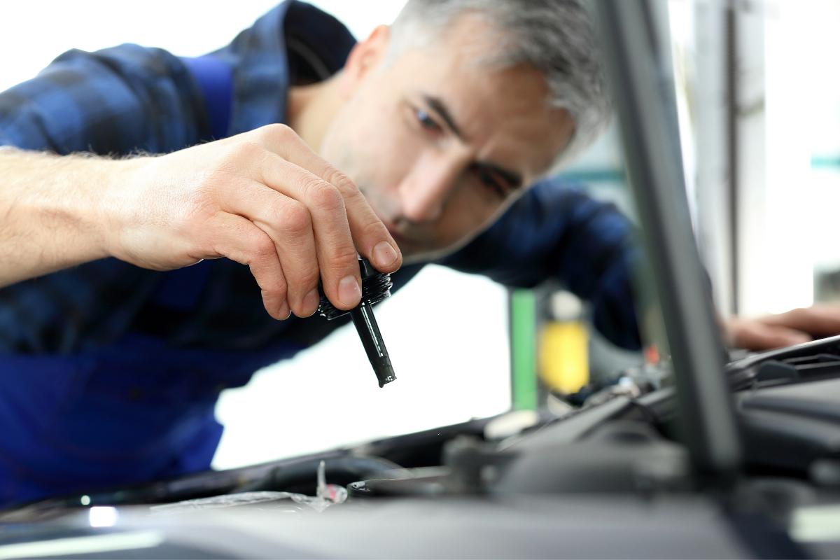 man checking power steering fluid