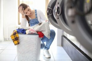 woman worried about car grease stain on clothes